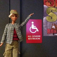 Faggotgirl with accessible bathroom sign